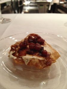 Chicken skin fried with bacon jam and rosemary mascarpone