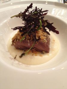 Pig cheeks with celeriac puree and mustard leaves