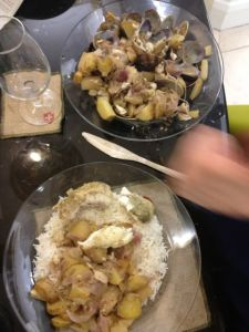 Hake & clams in cider.  Served with rice, but rice is definitely not needed (especially with a paella to follow).