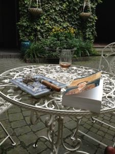 Afternoon in my almost-Andalucian courtyard.  Ramon Allones cigar.