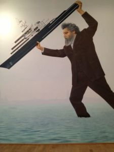 Britain: mural of William Morris (designer of the pavillion) dunking a yacht owned by Roman Abramovich (magnate of inter alia the art world).  The reference is to an incident, during the 2011 Biennale, where the yacht moored on the Riva dei Sette Martiri outside the Giardini, blocking the view of the lagoon, and rendering the embankment unuseable by pedestrians.